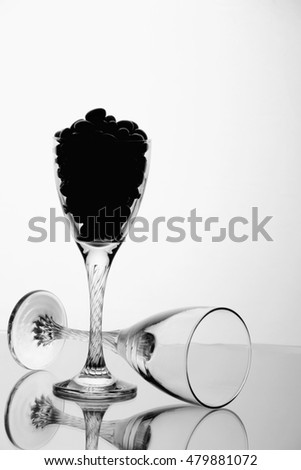 wine glasses with berries on white background