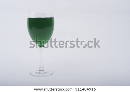 Wine Glasses with Brightly Colored Water on a White Background - Green