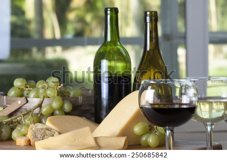 Wine, grapes and cheese - stock photo