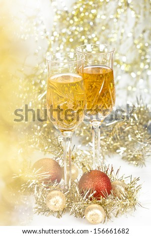 Wine in a glasses with christmas new year decorations and front bokeh