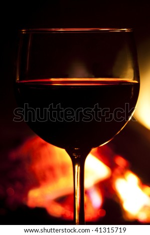 Wine in front of the fireplace - stock photo