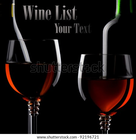 wine in glass and bottle isolated on solid black background - stock photo