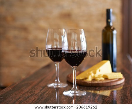 wine in glasses and cheese