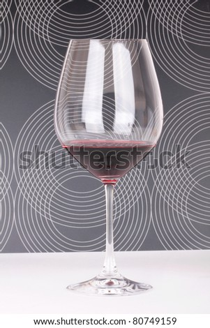 Wine in luxury glass, closeup on white