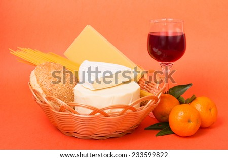 Wine, Italian pasta and red wine on the orange background