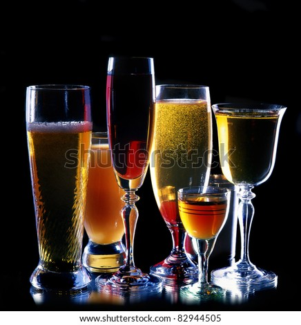 wine, juices, drinks on a black background - stock photo
