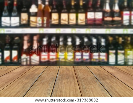 Wine Liquor bottle on shelf and wooden plank - Blurred background - stock photo