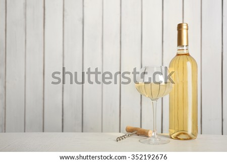 Wine on wooden wall background