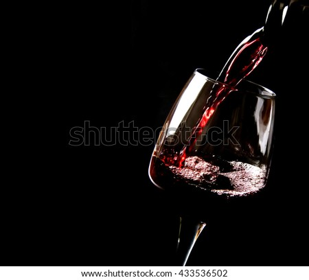 Wine poured on a glass - stock photo