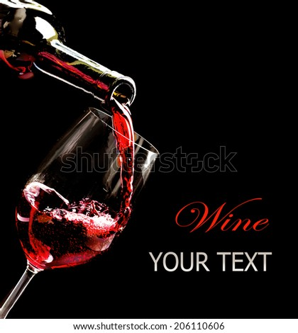 Wine. Red wine pouring into wine glass from the bottle. Isolated on black background. Art border design with space for your text - stock photo