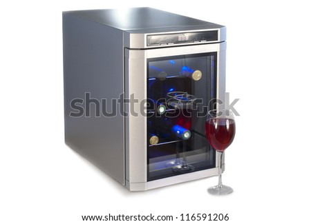 Wine refrigerator and glass of red wine.