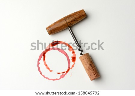 Wine stains cork and corkscrew on paper. Horizontal format. The stains are from wine bottle bottoms and drips. - stock photo