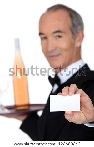 Wine steward showing a business card - stock photo