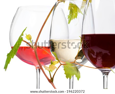 Wine. Three Glasses of wine isolated on white background. Glass of rose, red and white wine decorated with grape leaves. Vine leaf.  - stock photo