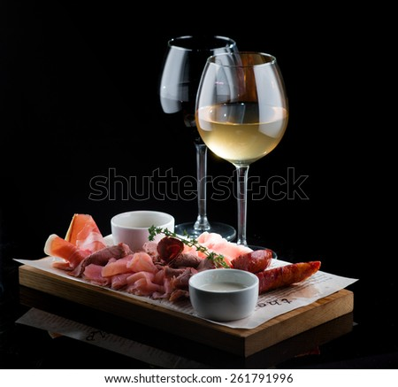 Wine, white, red meat in stock  - stock photo