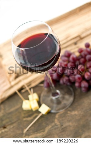wine with a tasty snack - stock photo