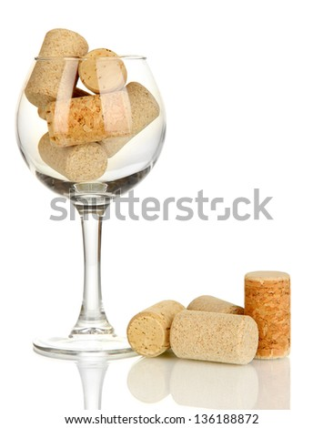 Wineglass and corks isolated on white - stock photo