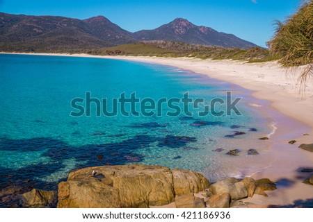 Wineglass Bay: The beautiful beach Wineglass Bay on the east coast of Tasmania has crysal clear water. - stock photo