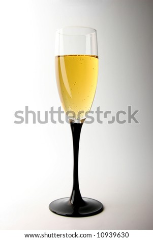wineglass full of champagne on white background - stock photo