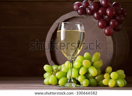 wineglass of vine on  wooden background - stock photo