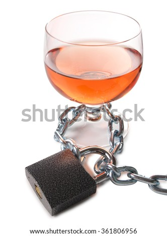 Wineglass of whiskey and metal chain        - stock photo