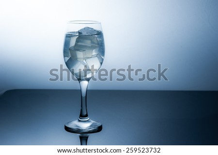 Wineglass with ice cubes