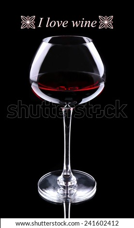 Wineglass with red wine and I love wine text, isolated on black - stock photo