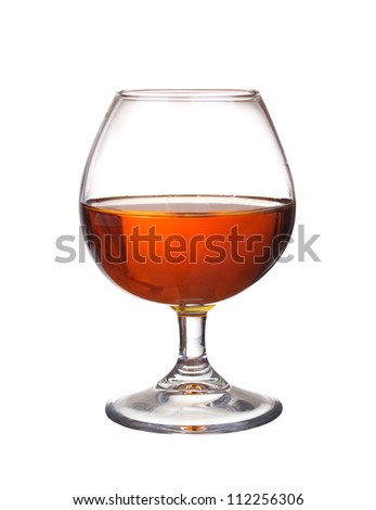 Wineglass with whiskey. Abstract drink composition - stock photo