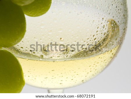 wineglass with white wine and grape - stock photo