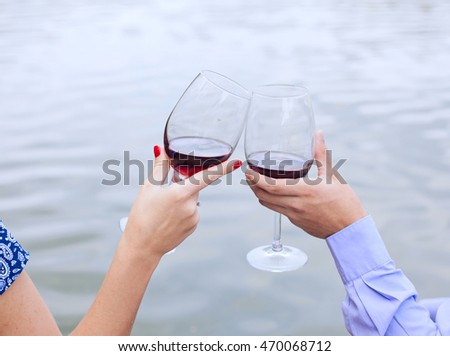 wineglasses in hands of newlyweds on the picnic, wedding day