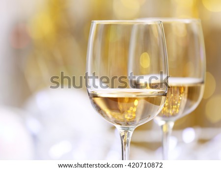 Wineglasses on blurred background - stock photo