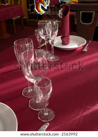 Wineglasses on table with purple tablecloth - stock photo