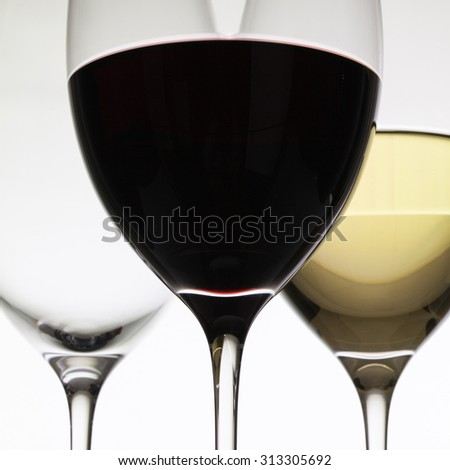 Wineglasses with red  and white wine on a white background