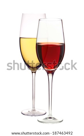 Wineglasses with white and red wine isolated on white - stock photo