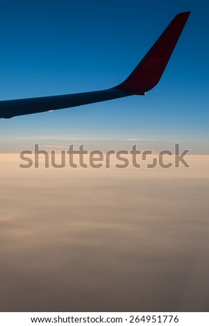 Wing of an airplane in the sky for  background