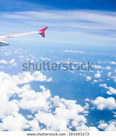 Wing over Lands Plane in the Air  - stock photo