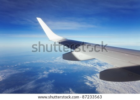 Wing passenger planes, blue sky and clouds. - stock photo