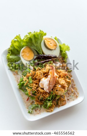 winged bean salad with shrimp and boiled egg on white background