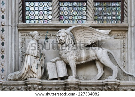 Winged lion, symbol of the city, with the Doge, on the Doge's Palace (Palazzo Ducale), San Marco, Venice. - stock photo
