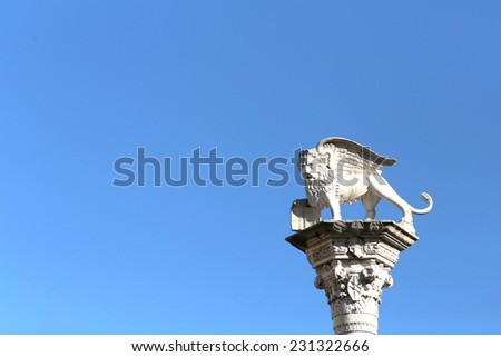 Winged Lion symbol of Venice and blue sky