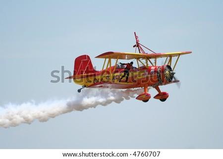 wingwalker on biplane - stock photo