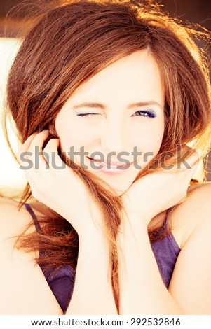 Winking Woman. Happy Smiling Fashion Model - stock photo