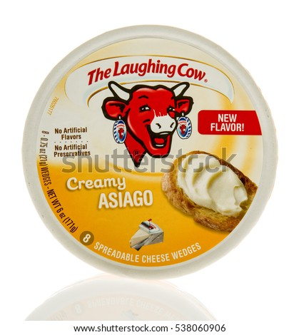 Winneconne, WI - 13 December 2016: Container of The Laughing Cow in creamy asiago flavor on an isolated background.