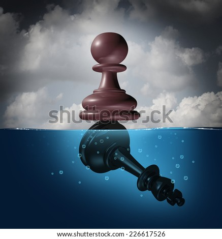 Winner and champion success concept as a chess pawn piece standing on top of a drowning king as a business metaphor for victory and defeat. - stock photo