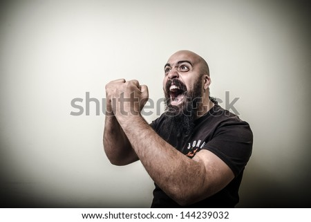 winner bearded man isolated on gray background - stock photo