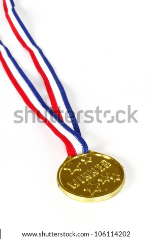 Winner Medal on red white and blue ribbon isolated on white. - stock photo