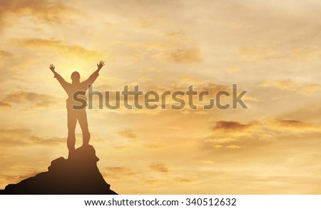 Winner on mountain top. bussiness and active life  - stock photo