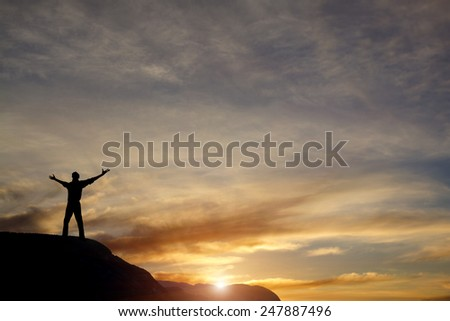 winner on mountain top - sport and active life concept - stock photo