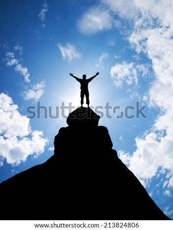 Winner on the mountain top. Sport and active life concept. - stock photo