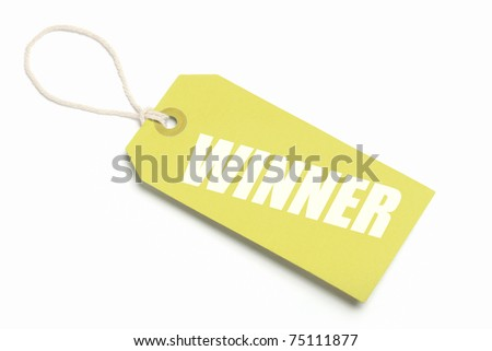 Winner Tag, Gold cardboard with string loop. Isolated on white. - stock photo
